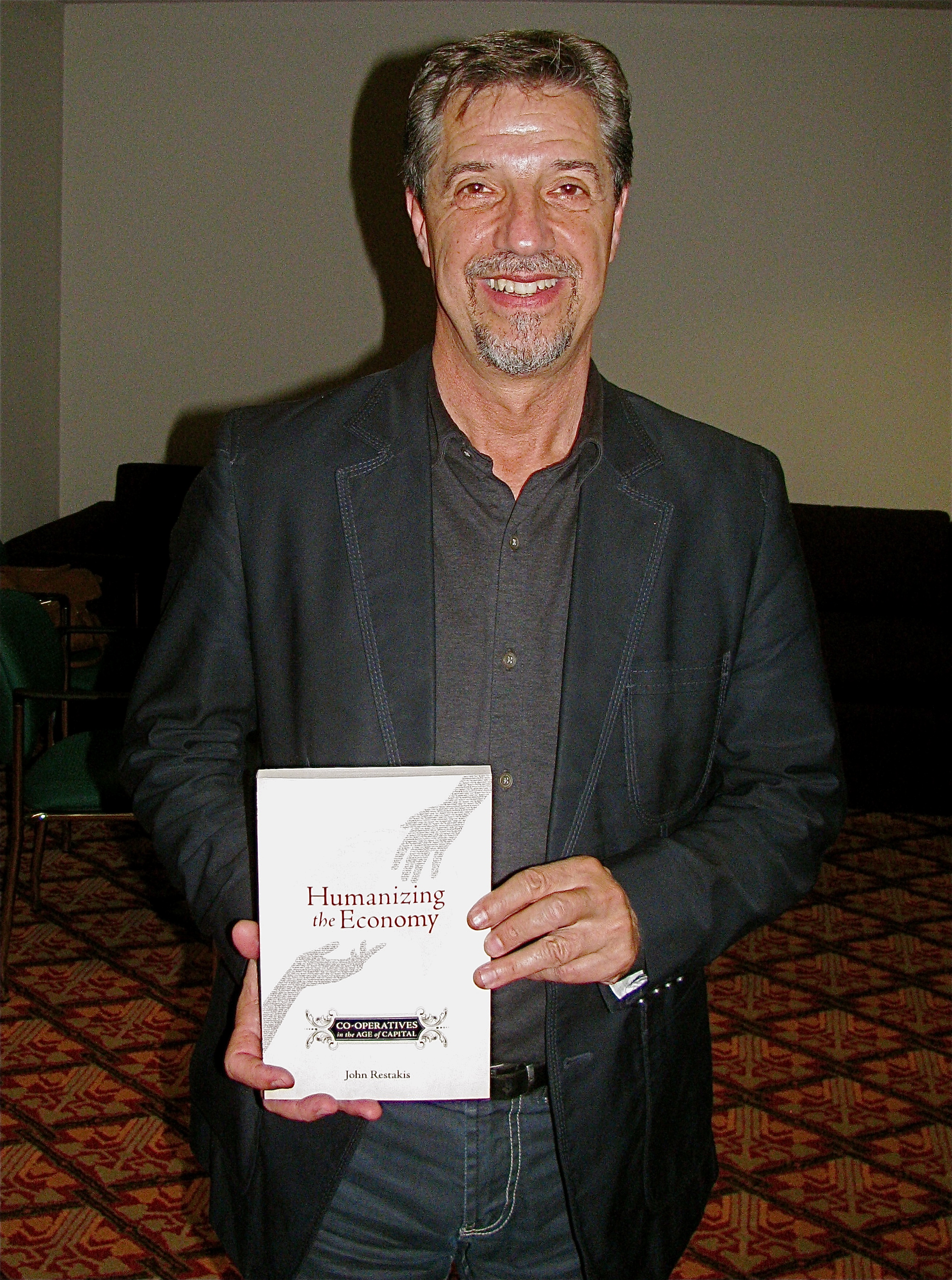 John Restakis with his book Humanizing the Economy